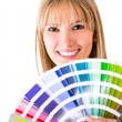 Stock Photo: Womselecting color to paint