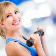 Woman lifting weights — Stock Photo #11747856