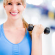 Woman exercising at the gym — Stock Photo #11747862