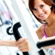 Woman exercising at the gym — Stock Photo #11747890