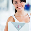 Fit woman with a scale — Stock Photo #11747898