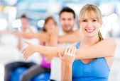 Exercising at the gym — Foto Stock