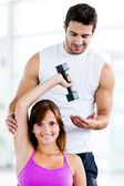 Fit woman with trainer — Foto Stock