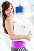 Woman loosing weight at the gym — Stock Photo