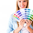 Woman selecting a color to paint - Stock Photo