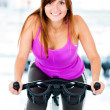 Womcycling at gym — Stock Photo #11848539