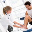 Royalty-Free Stock Photo: Injured man at the gym