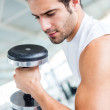 Stock Photo: Man lifting weights