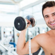 Stock Photo: Man working out at the gym