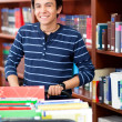 Man working at the library — Stock Photo