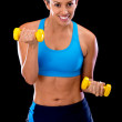 Woman lifting free-weights — Stockfoto