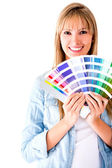 Woman selecting a color to paint — Stock Photo