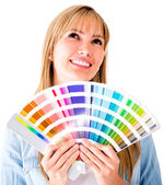 Woman thinking of redecorating — Stock Photo