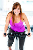Woman cycling at the gym — Stock Photo