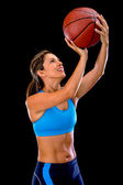 Female basketball player shooting — Stock Photo