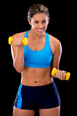 Woman lifting free-weights — Stock Photo