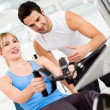 Stock Photo: Gym womwith trainer