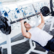 Stock Photo: Gym man lifting weights