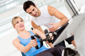 Gym woman with trainer — Stockfoto