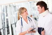 Injured man at the doctor — Stock Photo