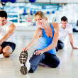 Stretching at the gym - Foto Stock