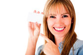 Woman holding business card — Stock Photo