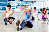 Stretching at the gym — Stock Photo