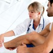 Gym doctor with a patient — Stock Photo #12007238