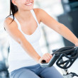 Gym woman doing spinning — Stock Photo #12007252