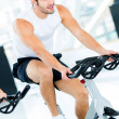 Mdoing spinning at gym — Stock Photo #12007253