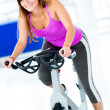 Gym woman doing spinning — Stock Photo #12007258