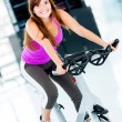 Womcycling at gym — Stock Photo #12007260