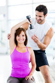 Woman with a personal trainer — Stock Photo