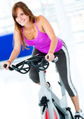 Gym woman doing spinning — Stock Photo