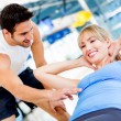 Gym woman with her trainer — Stock Photo #12046219