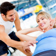 Gym womwith her trainer — Stock Photo #12046219