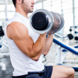 Stock Photo: Strong man at the gym
