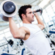 Gym man lifting weights — Stock Photo