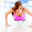 Gym womdoing push ups — Stock Photo #12046244