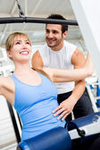 Gym woman with her trainer — Foto Stock