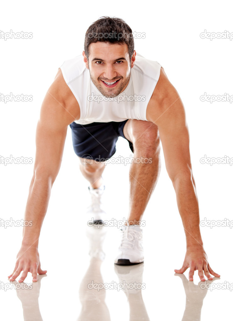 Competitive male athlete ready to run - isolated over a white background — Stock Photo #12107090