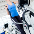 Woman on a cross trainer - Stock Photo