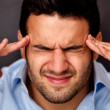 Stock Photo: Mwith headache
