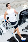 Gym man on the treadmill — Stock Photo
