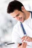 Doctor with a tablet computer — Stock Photo
