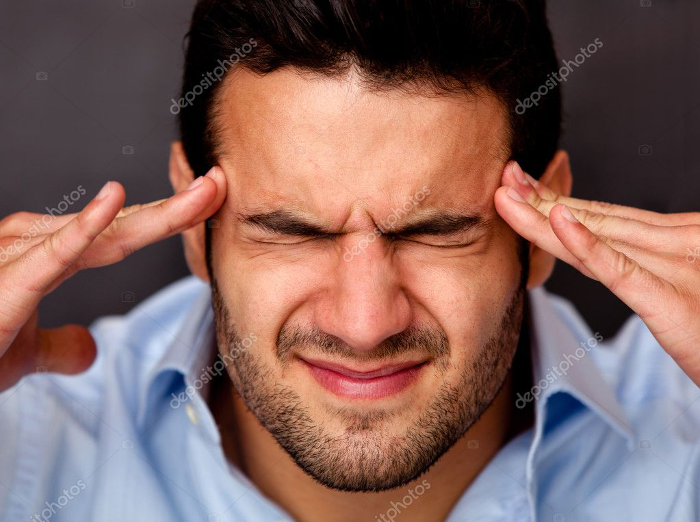Portrait of a business man with a headache — Stock Photo #12125149