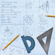 Mathematical desk with formulas and equipment — Stock Photo