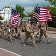 Stock Photo: Americsoldiers marching International Four Days Marches Nijmegen