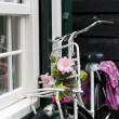 Bicycle with flowers - Stock Photo