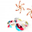 Hand painted colourful baubles on snow — Stock Photo